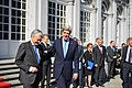 U.S. Secretary of State John Kerry walks with Belgian Minister Reynders at Egmont Palace in Brussels, Belgium, on April 24, 2013.jpg