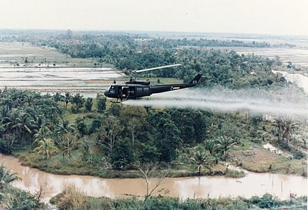 U.S. Army Huey helicopter spraying Agent Orange during the Vietnam War US-Huey-helicopter-spraying-Agent-Orange-in-Vietnam.jpg