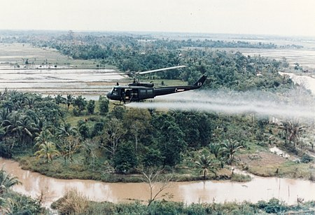 U.S. Army Huey helicopter spraying Agent Orange over Vietnamese agricultural land US-Huey-helicopter-spraying-Agent-Orange-in-Vietnam.jpg