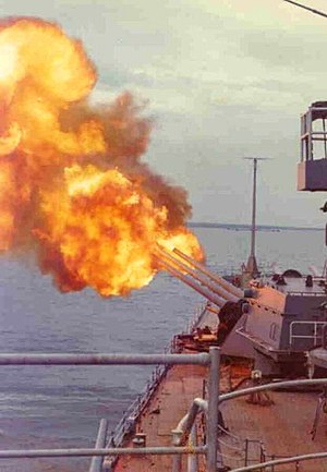 USS Newport News (CA-148) - USS Newport News firing a broadside during her 1972 Vietnam deployment.