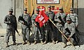 US Army 52308 130th Eng. get C-IED aid from explosive hazards team.jpg