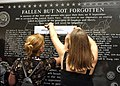 US Navy 020911-N-4868G-052 Family and friends of Navy personnel lost in the Sept. 11, 2001 attack on the Pentagon make pencil rubbings of the names of their lost loved ones.jpg