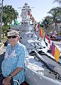 US Navy 030704-N-1159B-003 Lt. Cmdr. Walter L. Riter, USN Ret., participates in the 99th Annual Huntington Beach Fourth of July Parade with a large scale model of the World War II battle ship USS Nevada (BB 36).jpg