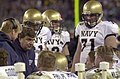 US Navy 031206-N-9693M-508 Navy head coach Paul Johnson talks to the offensive line during the 104th Army Navy Game.jpg