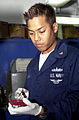 US Navy 040421-N-7949W-003 Hospital Corpsman 2nd Class Patrick C. Mangaran from Beach Park, Ill, swabs a bacteria culture for further examination.jpg