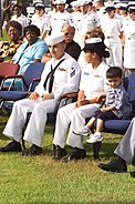 US Navy 040811-N-0000N-005 Hospitalman Apprentice Luis E. Fonseca, Jr., sits with his family