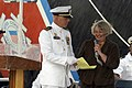 US Navy 041015-N-7293M-163 Commanding Officer, USCG Sequoia (WLB 215), Lt. Cmdr. Matthew T. Meilstrup, holds the page steady as Mrs. Dorothy England makes her remarks.jpg