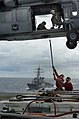 US Navy 050627-N-8604L-283 Weapons department personnel assigned aboard the USS Kitty Hawk (CV 63) prepare to off-load equipment to an MH-60S Knighthawk from Helicopter Sea Combat Support Squadron Two Five (HCS-25) during a ver.jpg
