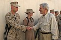 US Navy 050901-M-1327J-006 U.S. Senator Jon Warner of Virginia, greets and shakes hands with Marines stationed at Camp Al Taqaddum, Iraq.jpg