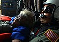 US Navy 050905-N-0535P-047 U.S. Navy search and rescue swimmer Aviation Warfare Systems Operator 1st Class Scott Chun comforts a victim of Hurricane Katrina pulled from a rooftop in New Orleans as they fly to safety aboard a U.jpg