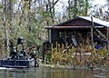 US Navy 050908-N-4345B-005 U.S. Navy Special Warfare Combatant-craft Crewmen (SWCC), assigned to Special Boat Team Twenty Two (SBT-22), search for survivors of Hurricane Katrina along the banks of the Pearl River.jpg