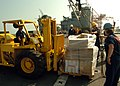US Navy 051021-N-0716S-005 Sailors aboard the U.S. Navy dock landing ship USS Pearl Harbor (LSD 52) load a palate containing food and clothing donated to the people of Pakistan by the citizens of United Arab Emirates (UAE).jpg
