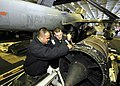 US Navy 060330-N-7981E-082 Aviation Structural Mechanic Airman Christopher Salge, left, and Aviation Machinist's Mate Third Class Aaron Geiger, assigned to Electronic Attack Squadron One Three One (VAQ-131) perform maintenance.jpg