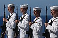 US Navy 060602-N-0684R-075 The Honor Guard presents arms prior to rendering honors during a burial at sea ceremony aboard the Nimitz-class aircraft carrier USS John C. Stennis (CVN 74).jpg