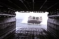 US Navy 070105-M-6412J-098 A Landing Craft Air Cushion LCAC enters the well deck of amphibious assault ship USS Bataan LHD 5, with vehicles and troops assigned to 26th Marine Expeditionary Unit 26 MEU.jpg