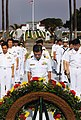 US Navy 070613-N-4163T-015 Captain Takanari Murata, commander, Escort Division 4 Japan Maritime Self-Defense Force (JMSDF), bows his head along with other Japanese Sailors during a wreath-laying ceremony at Fort Rosecrans Natio.jpg