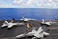 US Navy 070809-N-9760Z-012 A group of F-A-18 Hornets and Super Hornets attached to Carrier Air Wing (CVW) 11 prepare to launch off the flight deck of the nuclear-powered aircraft carrier USS Nimitz (CVN 68).jpg