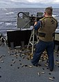 US Navy 080216-N-5253W-004 Gunner's Mate 2nd Class Jami Kilmer of the Arleigh Burke-class guided-missile destroyer USS Fitzgerald (DDG 62) fires dual .50-caliber machine guns.jpg
