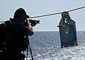 US Navy 080619-N-2838W-126 Gunner's Mate 2nd Class James Hults, a member of the visit, board, search and seizure (VBSS) team aboard the guided-missile destroyer USS Bulkeley (DDG 84), practices essential gun-firing procedures w.jpg