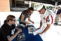 US Navy 080710-N-8848T-016 Aviation Maintenance Administrationman Shon Nuanez gives four die-cast No. 88 Navy Accelerate Your Life models to NASCAR Nationwide Series driver Brad Keselowski to autograph.jpg