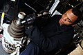 US Navy 090227-N-9760Z-013 Aviation Support Equipment Technician Airman William Brewer repairs a 12-ton jack.jpg