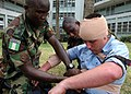 US Navy 090324-N-1655H-259 Nigerian infantrymen practice treating battle wounds on Operations Specialist 3rd Class Brain Sutton.jpg