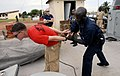 US Navy 090429-N-7948C-028 Aviation Boatswain's Mate (Fuels) 3rd Class Faron Goff is handcuffed by a Gabonese sailor during an Africa Partnership Station Nashville visit, board, search and seizure workshop in Port Gentil.jpg