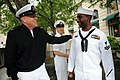 US Navy 090604-N-9818V-322 Force Master Chief Michael Holdcraft, left, speaks with Steelworker 2nd Class Herbert Collins and Master Chief Petty Officer of the Navy (MCPON) Rick West after a Battle of Midway commemoration wreath.jpg