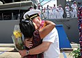 US Navy 090720-N-3666S-072 A Sailor assigned to the Arleigh Burke-class guided-missile destroyer USS Chung-Hoon (DDG 93) embraces his wife pier side at Naval Station Pearl Harbor.jpg