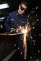 US Navy 090801-N-2791J-201 Hull Maintenance Technician 3rd Class Miguel Thompson from Engineering Department, R-1 Division aboard the aircraft carrier USS Carl Vinson (CVN 70), cuts carbon steel with an oxyacetylene torch.jpg