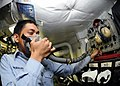 US Navy 091009-N-6567V-047 Aircrew Survival Equipmentman Airman Kervin Morales assigned to the Dambusters of Strike Fighter Squadron (VFA) 195 tests an oxygen mask aboard the aircraft carrier USS George Washington (CVN 73).jpg