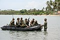 US Navy 110704-N-WL717-039 Members of an Armed Forces of the Philippines Marine battalion landing team and a Sailor assigned to U.S. Navy Riverine.jpg