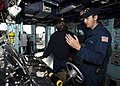 US Navy 111206-N-FI736-097 Boatswain's Mate Seaman Cameron Fitzgibbon, right, teaches Boatswain's Mate Seaman Brandon Williams how to stand watch a.jpg