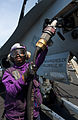 US Navy 120202-N-OY799-024 Airman Recruit Chelsea Heard fuels an F-A-18C Hornet from the Golden Dragons of Strike Fighter Squadron (VFA) 192 on the.jpg
