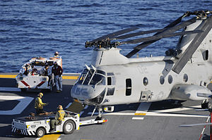 US Navy 120208-N-ZZ999-013 Aviation boatswain's mates maneuver a CH-46 Sea Knight helicopter assigned to Marine Medium Helicopter Squadron (HMM) 36.jpg