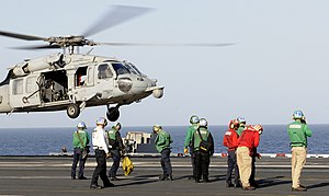 US Navy 120214-N-DH811-030 An MH-60S Sea Hawk helicopter assigned to the Golden Falcons of Helicopter Sea Combat Squadron (HSC) 12 takes off from t.jpg