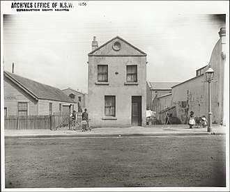 The Rocks, New South Wales - A dwelling in an unidentified street at The Rocks, date unknown.