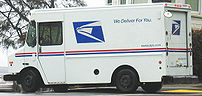 USPS service delivery truck in a residential a...
