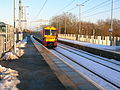 Uphall railway station - departing train.JPG