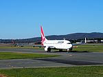 VH-VZR taxiing at Canberra Airport March 2013.jpg