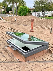 A venting skylight powered by an onboard solar panel operated by a remote control to vent warm air from inside.