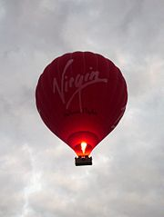A Virgin hot air balloon flying over Cambridge.