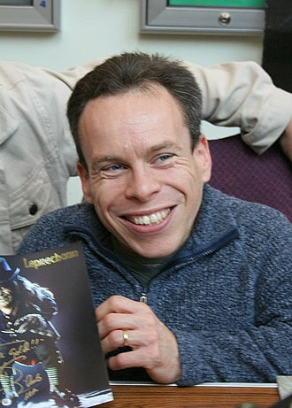 Leprechaun (film) - Warwick Davis signs Leprechaun merchandise at the Norwich Sci-Fi Film, Toy, and Collectors' Fair in 2006