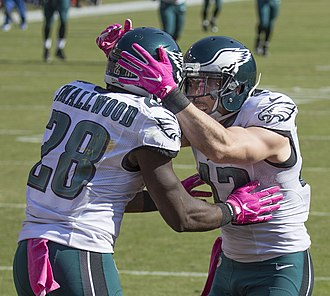 Wendell Smallwood - Smallwood (left) celebrates a touchdown with teammate Chris Maragos