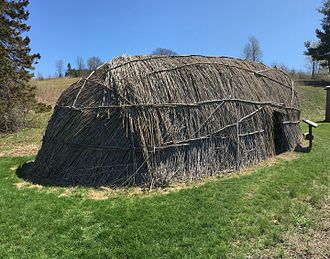 Chaubunagungamaug Reservation - A recreation of a wetu at Fruitlands Museum in Harvard, Massachusetts.  The Praying Indians faced restrictions aimed to assimilate them into English society and eliminate traditional religion, but they continued to maintain Native dwellings—such as the wetu, language, tribal hierarchy and certain customs in the Praying Towns.