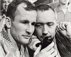Gemini 4 - White (l) and McDivitt being congratulated by President Lyndon B. Johnson by telephone aboard the aircraft carrier USS Wasp