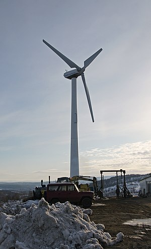 Wind power in Russia - Wind turbine near an Omni Hotel, Murmansk. The wind power potential of Murmansk Oblast is one of the largest among regions of Russian.