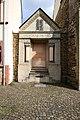 Wittlich an der alten Synagoge. Neoromanische Steinumrahmung des vormaligen Toraschreins.jpg
