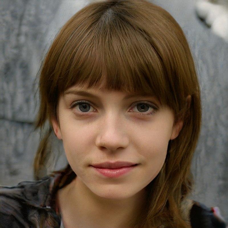 Image générée par le réseau adverse génératif StyleGAN, en se basant sur une analyse de portraits. L'image ressemble fortement à une photographie d'une vraie personne.