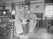 Women making 9.2 inch gun cordite charges WWII IWM D 667